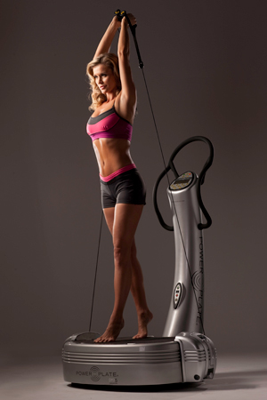 Joanna Krupa on a Power Plate machine
